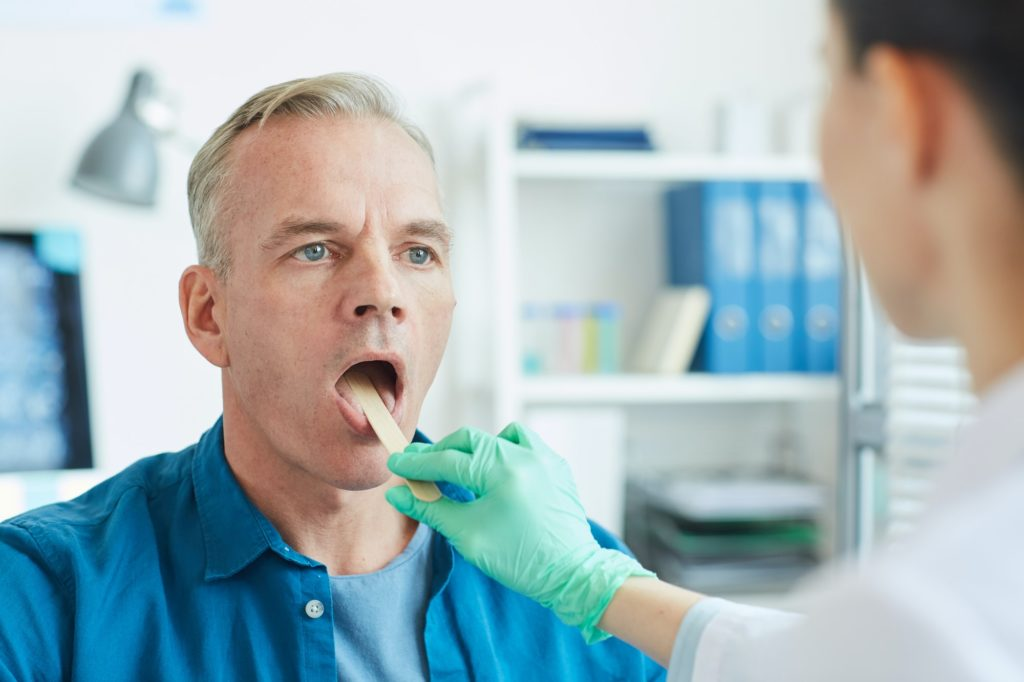 Mature Patient Opening Mouth